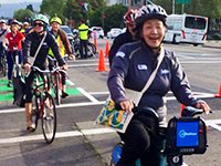 Oakland Mayor Jean Quan rides a bicycle along the demonstration bike lane
