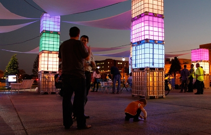 Colorful lighting at a pop-up plaza demonstration in Camden, New Jersey