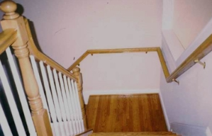 A staircase with double handrails.