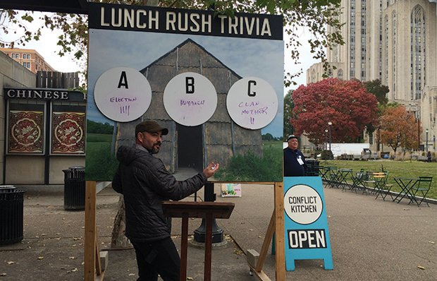 A staff member at the Conflict Kitchen in Pittsburgh leads a game of Lunch Rush Trivia