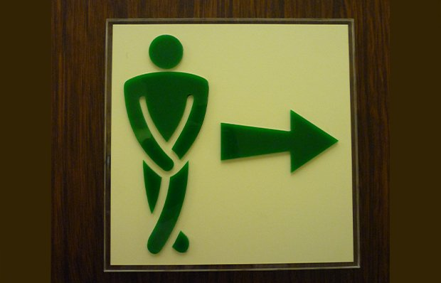 Sign indicating the location of a rest room.