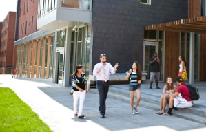 A wide sidewalk at Gallaudet University enables people to walk side-by-side whlie speaking in sign language.