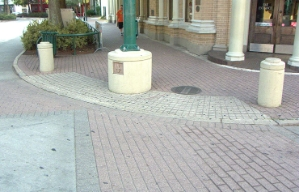 Streets and sidewalks made of the same materials and no curb can be confusing for vision impaired people to navigate.