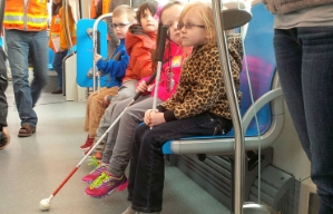 Children with vision impairments take a ride on the Kansas City, Missouri, streetcar.