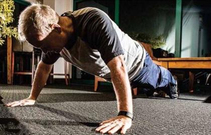 Mick Cornett, Mayor of Oklahoma City, Oklahoma, does a push-up