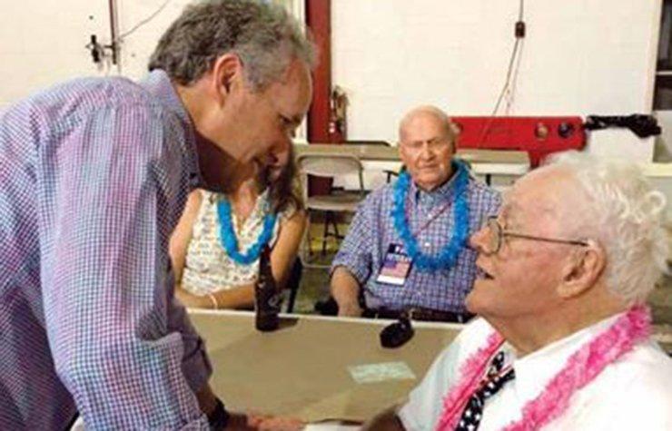 Greg Fischer, Mayor of Louisville, Kentucky, visits with a senior citizen