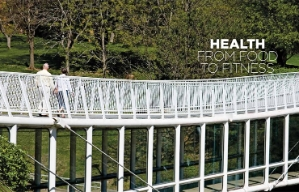 Two people walk along a bridge in an Oklahoma City park as shown in the Health chapter opener of the book Where We Live