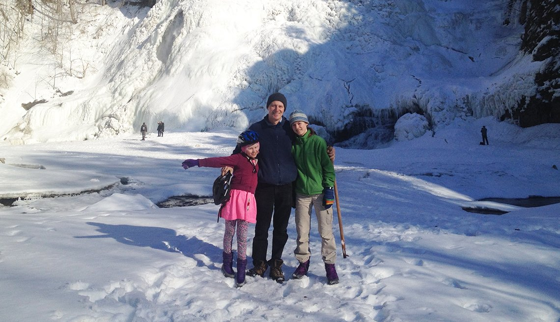 Robert Steuteville and his children pose in the snow in Ithaca, New York