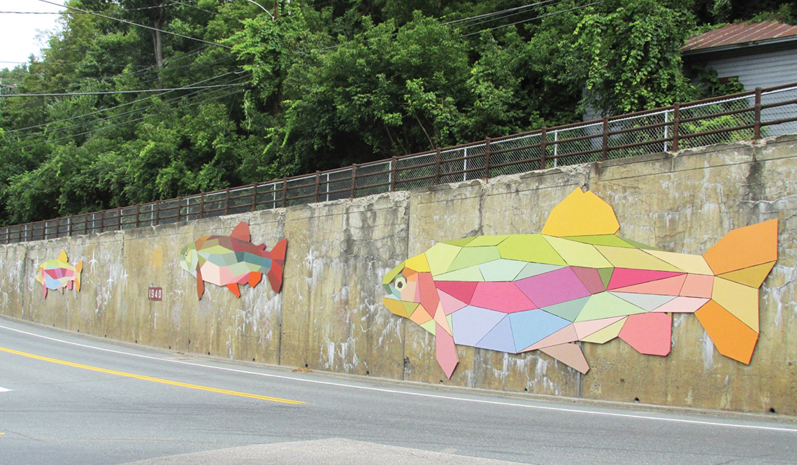 A fish themed mosaic on a roadway wall in Bethel, Vermont
