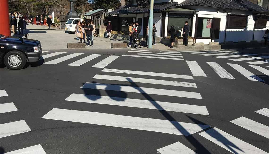 Multiple crosswalks provide paths for pedestrians in Kamakura, Japan.