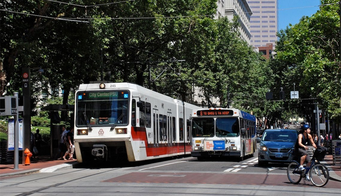 Streetcars, cars, pedestrians, buses and bicycles share the road in Portland, Oregon