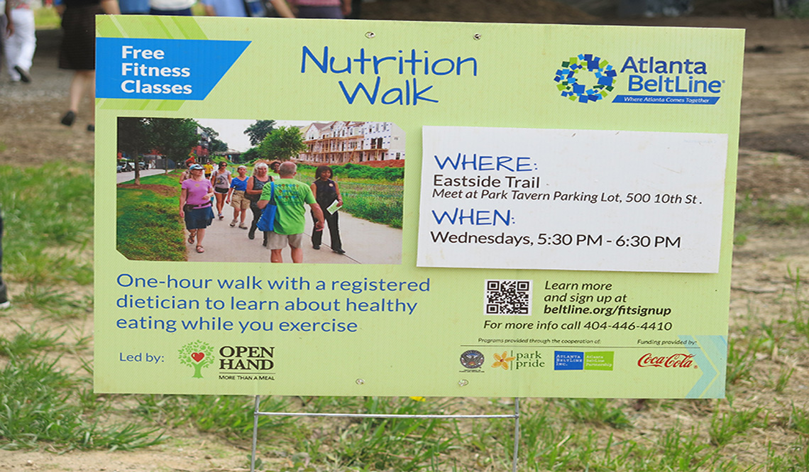 A sign promoting a Nutrition Walk on the Atlanta BeltLine
