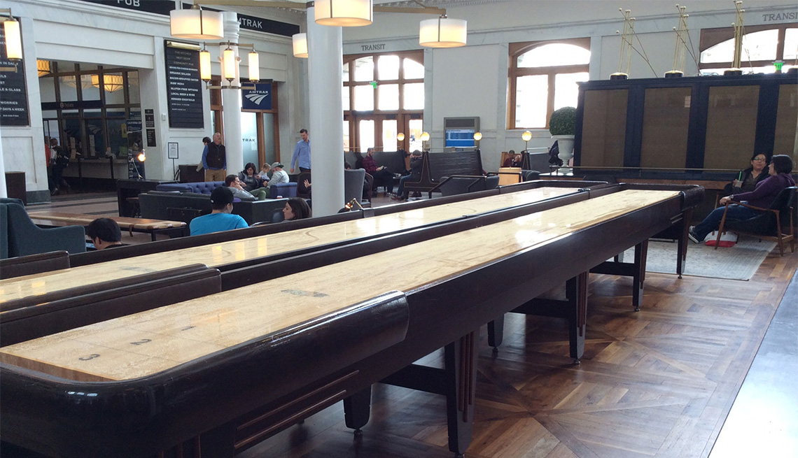 The waiting area of Denver's historic Union Station features couches and games.