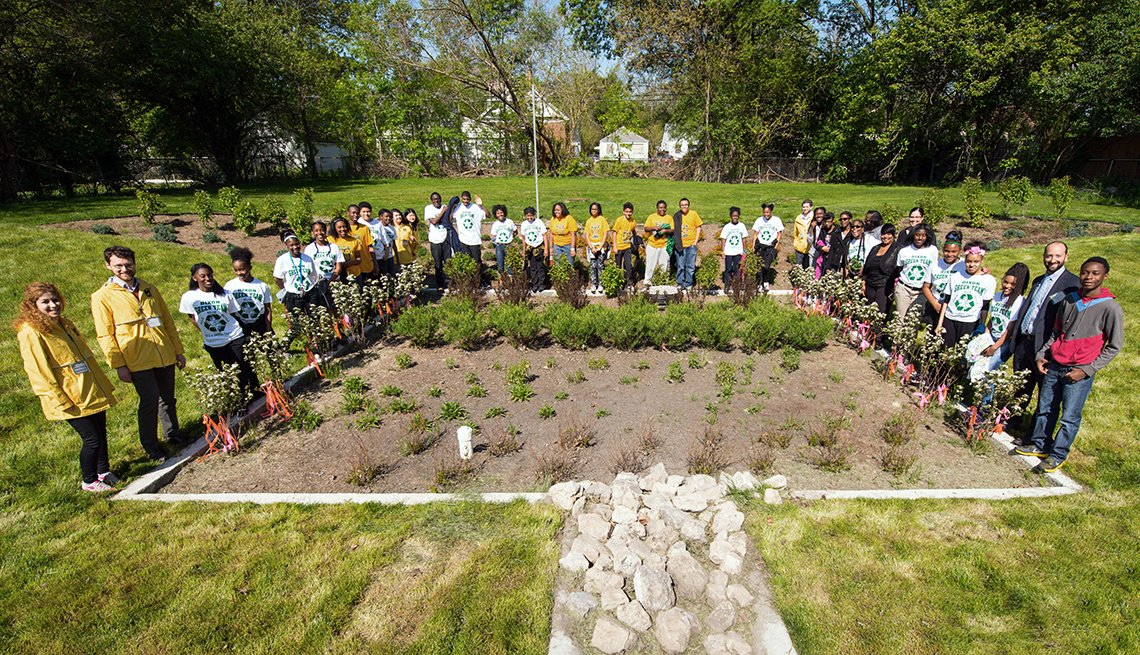 Community leaders, residents and students celebrate the transformation of a vacant lot into a biorention garden in Detroit, Michigan