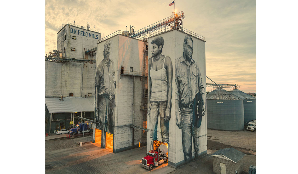 Grain towers display three enormous portraits of Fort Smith residents as painted by Guido Van Helten