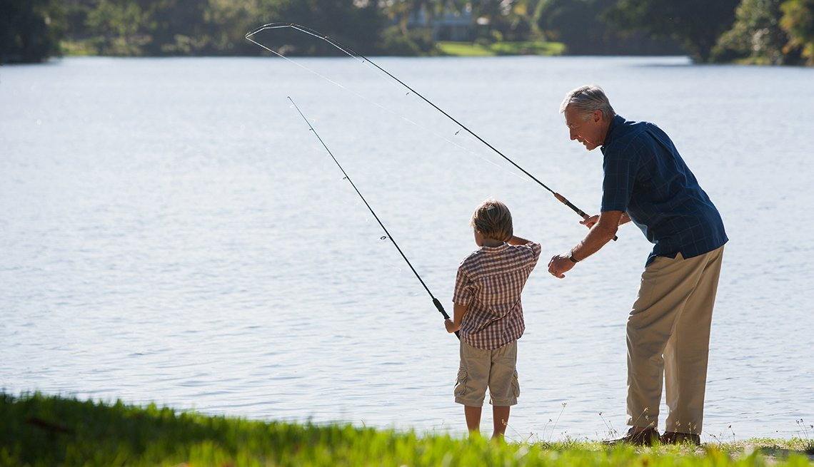 Grandfather and boy fishing together.