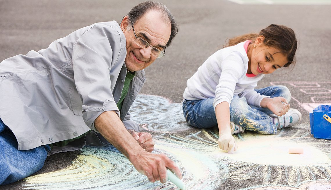 Hispanic grandfather and granddaughter, drawing, sidewalk, chalk, Livable Communities, AARP Network of Age-Friendly communities
