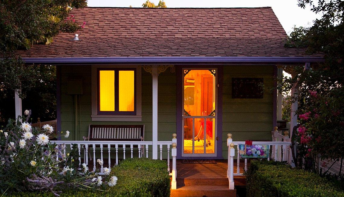 Cottage with Open Door, Dusk, Flowers, Porch, AARP Livable Communites, All About Housing