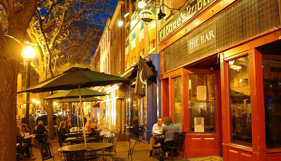 People in sidewalk cafes, evening, West Chester, Pennsylvania, AARP Livable Communities
