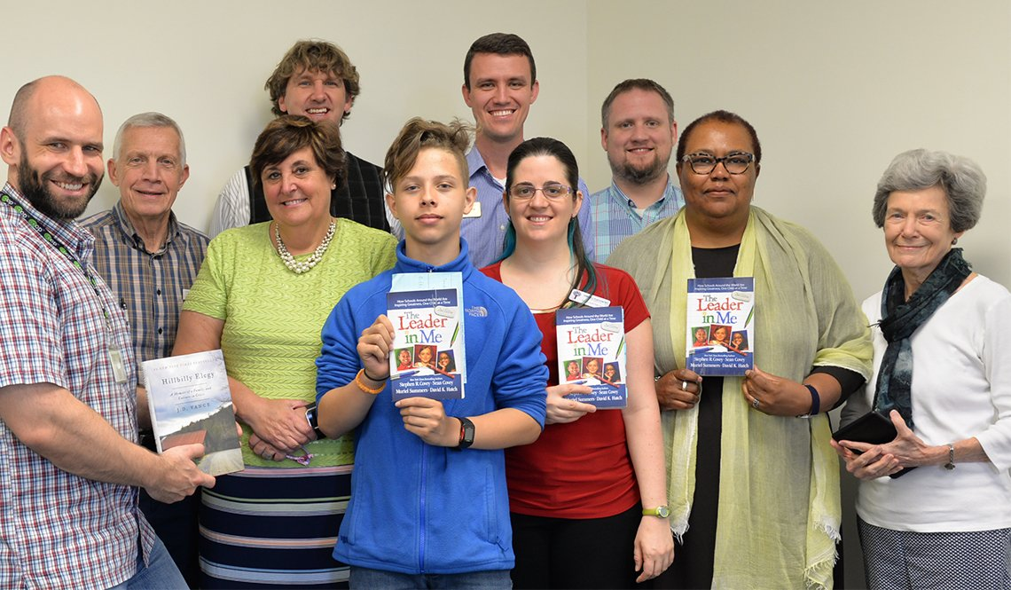 Mayor Ian Balutrus and members of the Mayor's Book Club in Burlington, North Carolina