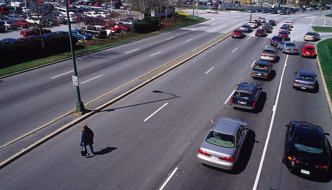 Pedestrian Crosses Busy Street, Traffic, Cars, No Sidewalk, No Cross Walk, Livable Communities, Dangerous By Design Report