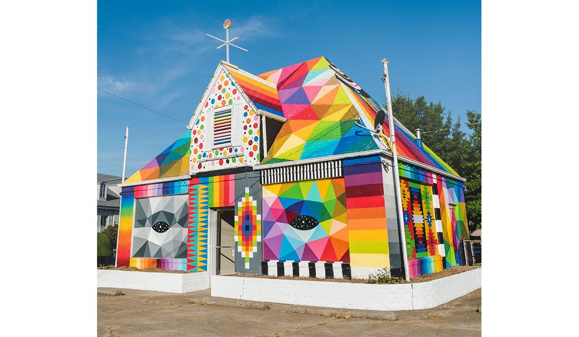 An abandoned house as painted in bright colors by muralist Okuda San Miguel