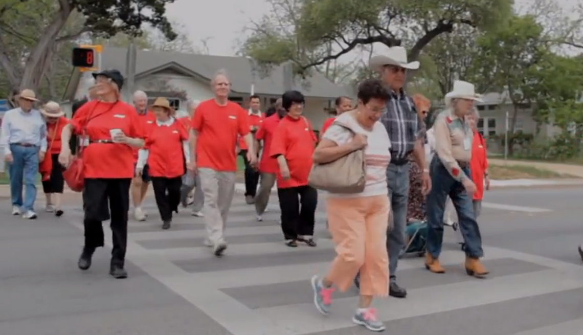 Seniors coming from a bus stop on Manchaca Road in South Austin, Texas