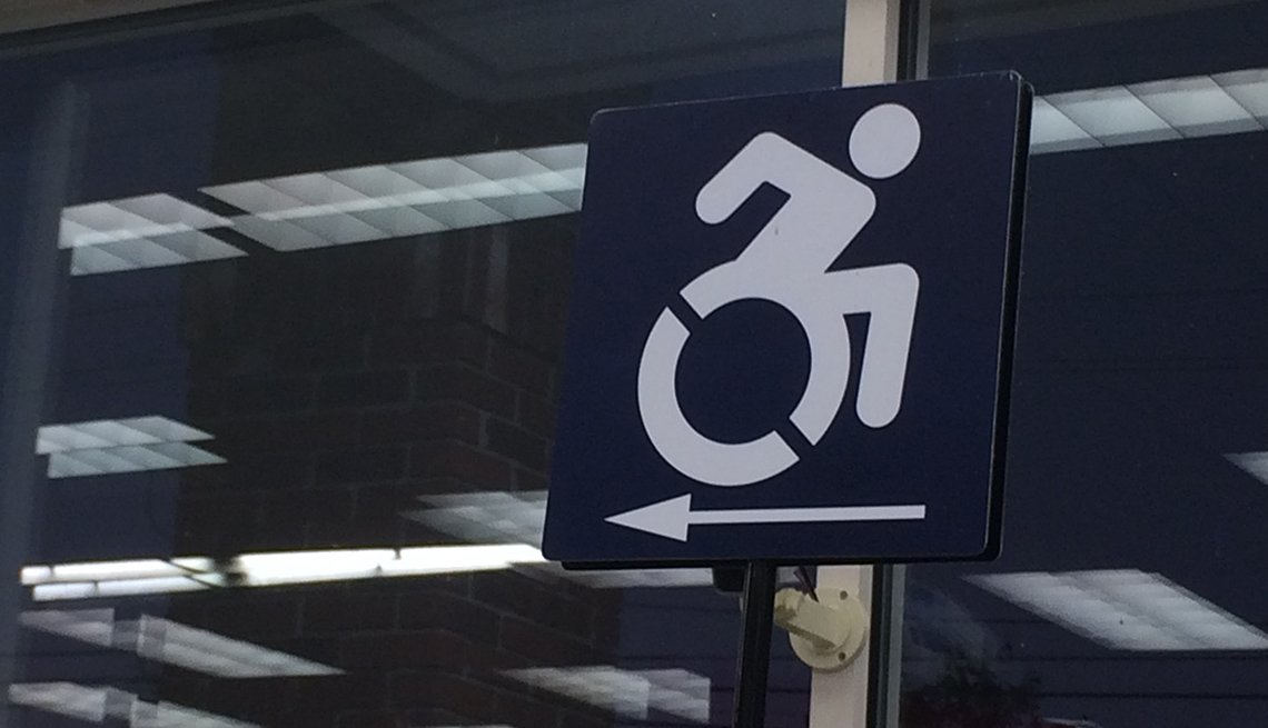 A wheelchair route directional sign