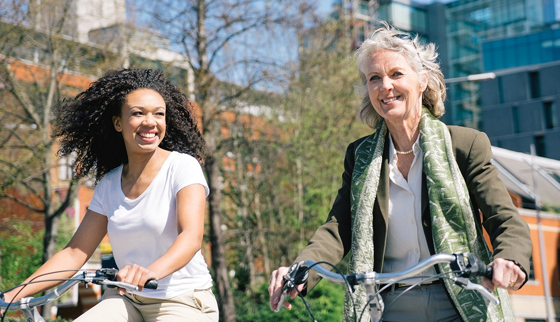 Women Ride Bicycles, City Environment, Sunny Outdoors, AARP Livable Communities Tool Kits Resources