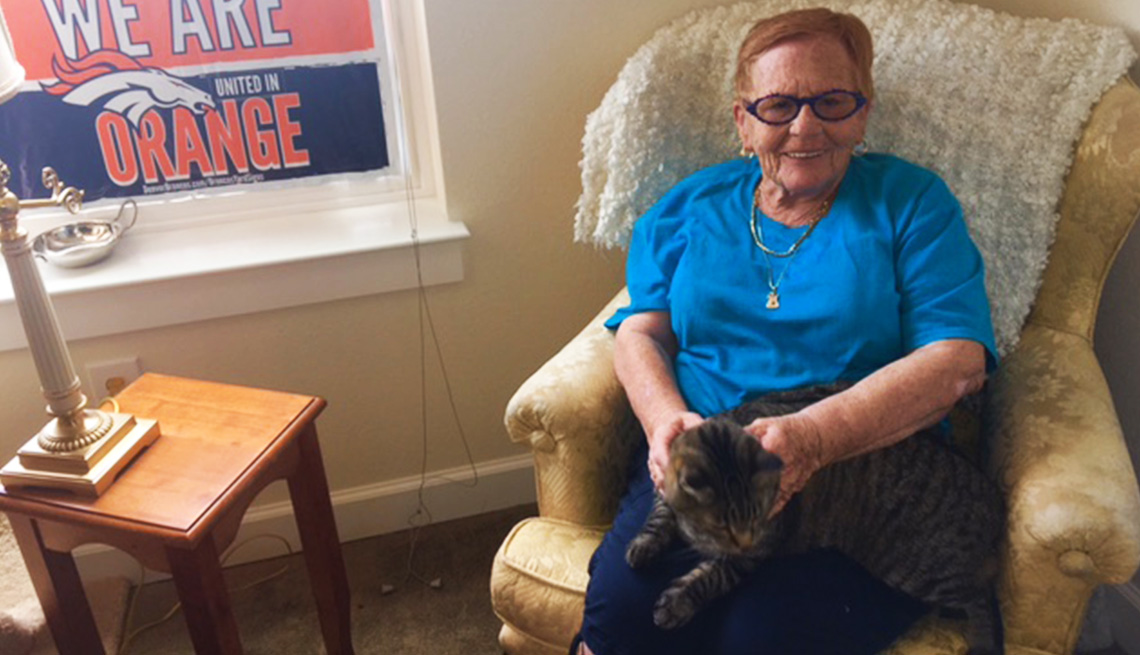 A Yale Station resident sitting with her cat.