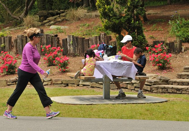 Jogger and family in park, Livable Communities.