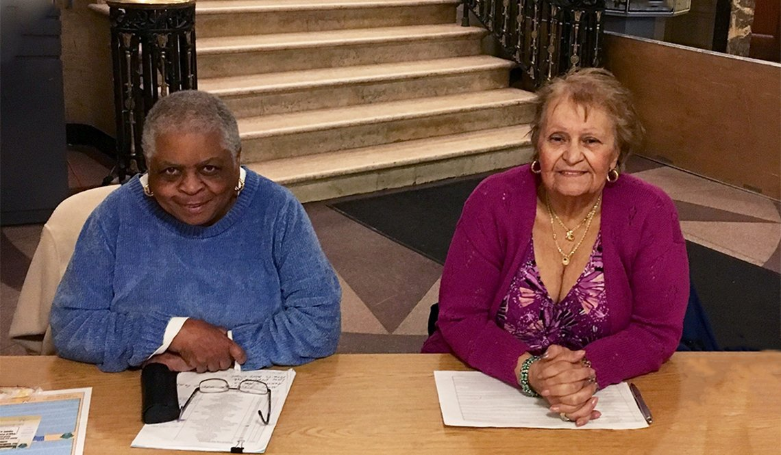 Two women volunteer as City Hall greeters in Medford, Massachusetts