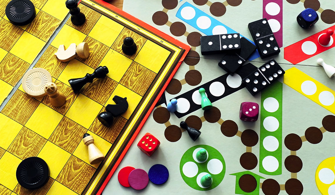 A photo collage of game board and game pieces.