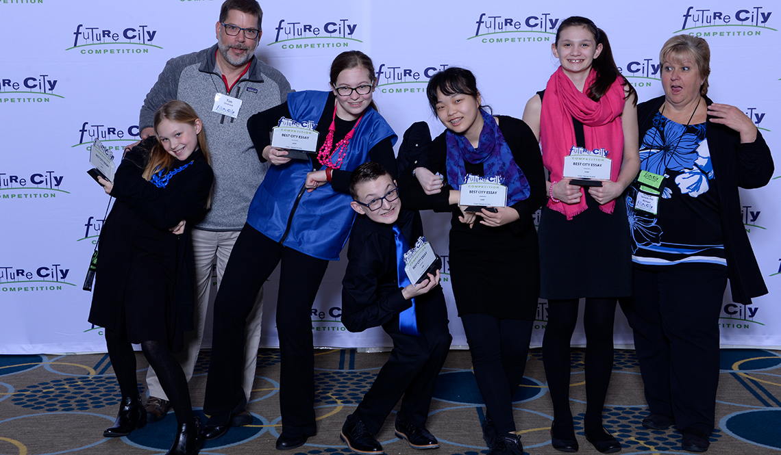 Members of the Michigan team strike a fun pose after being awarded best essay at the 2018 Future City Competition