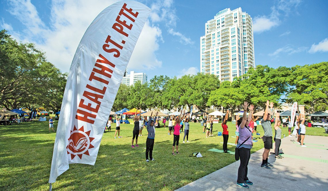 A group exercise class takes place in a St. Petersburg, Florida, park as part of the annual Healthy St. Pete festival