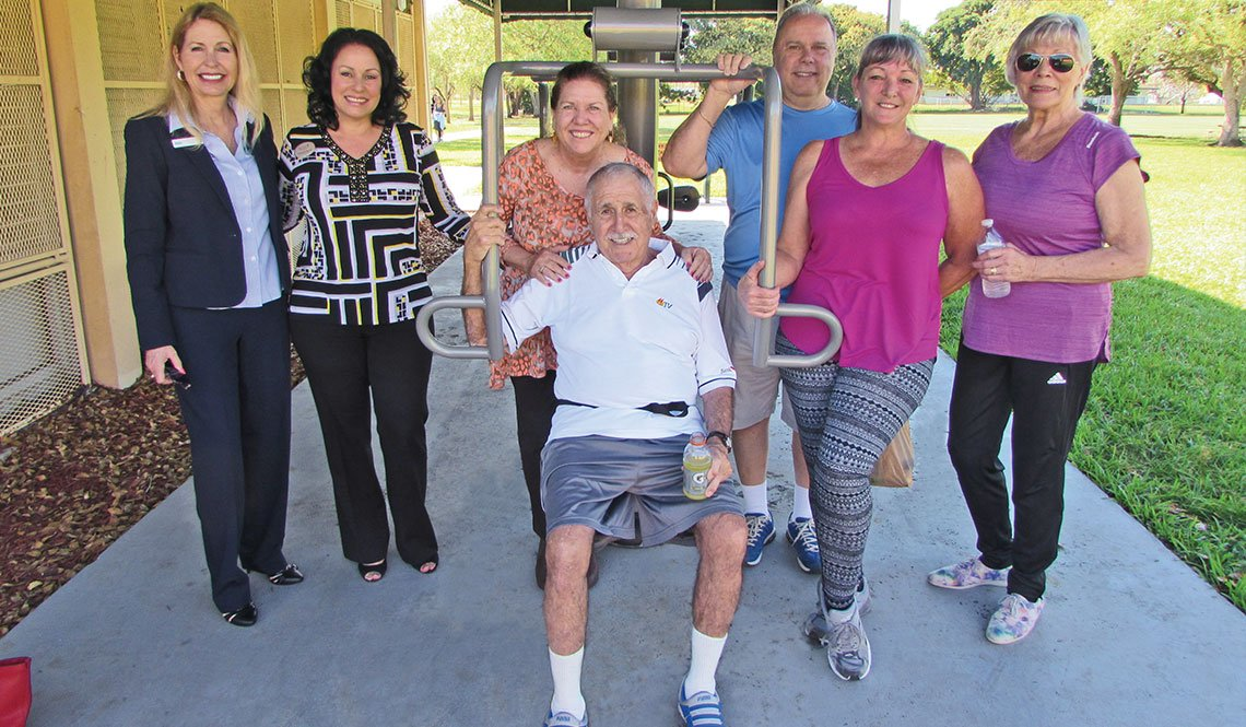 Residents of Cutler Bay, Florida, show off the senior center's new exercise equipment.