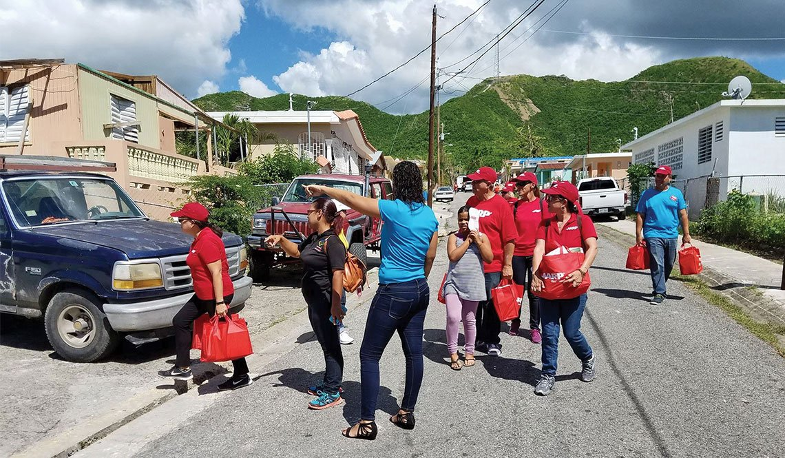 Staff and volunteers from AARP Puerto Rico deliver food to older adults after Hurricane Maria.