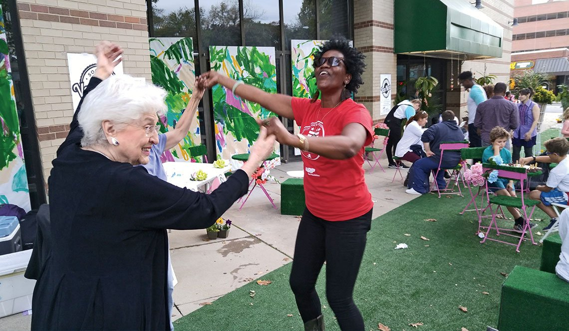 Two women dance at a block party in Washington DC
