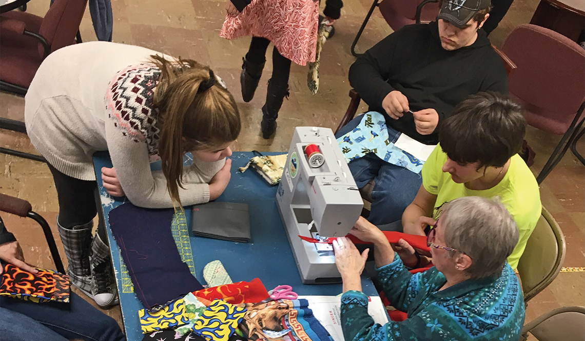 Teenagers learn to sew at the Boys and Girls Club in Augusta, Maine