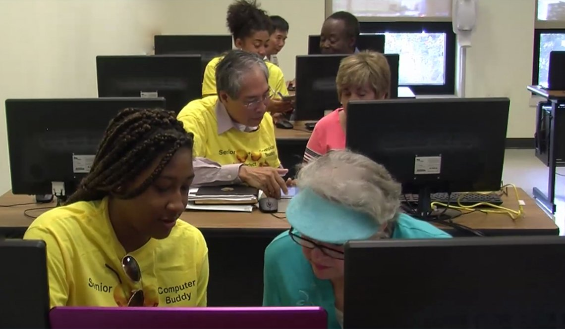 Volunteers teach computer skills to older adults at a senior center