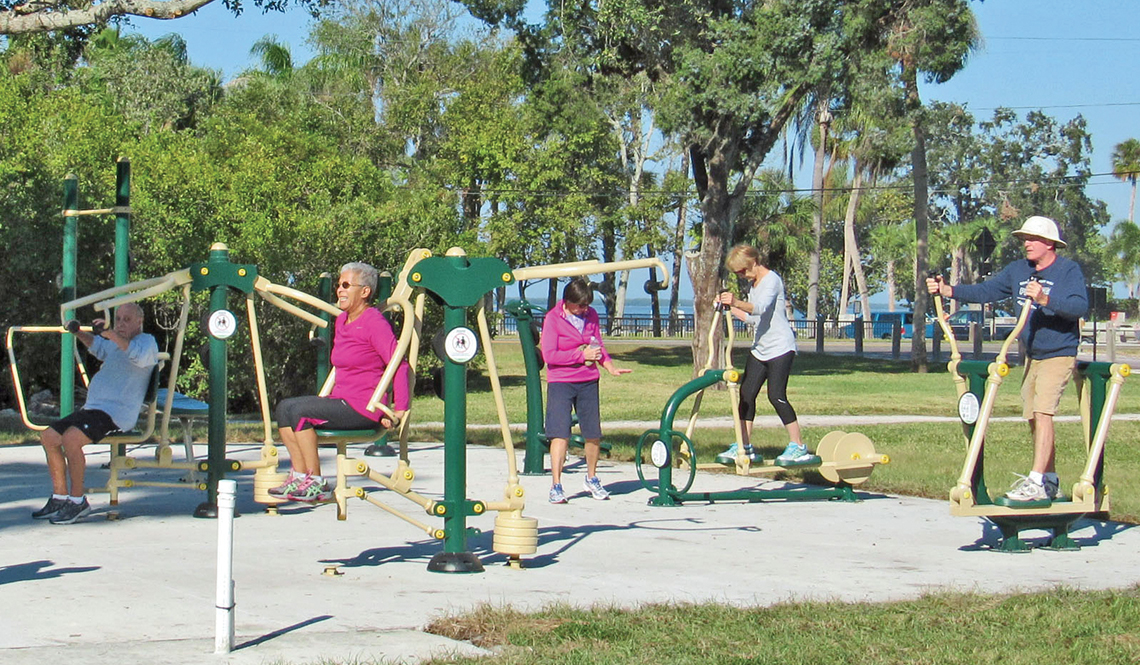 Older adults work out at a Fitness Zone in Dunedin, Florida's Weaver Park.
