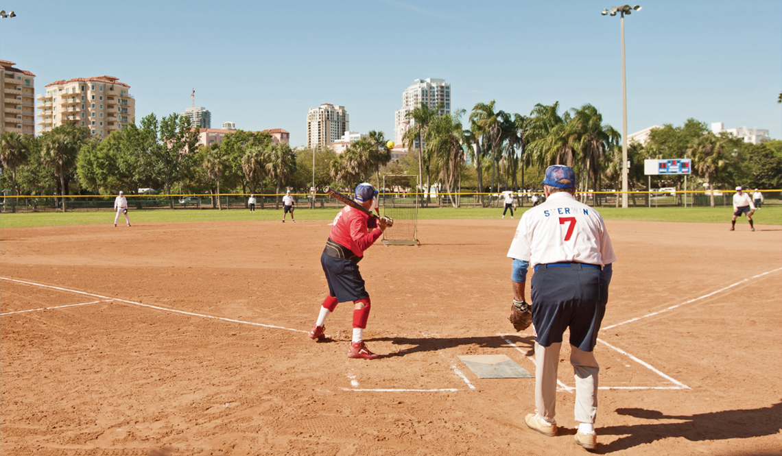 A batter at home plate during a Kids and Kubs softball game
