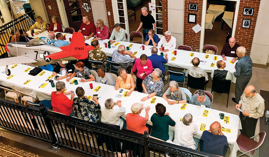 Diners gather at long tables for an Out4Supper dinner.