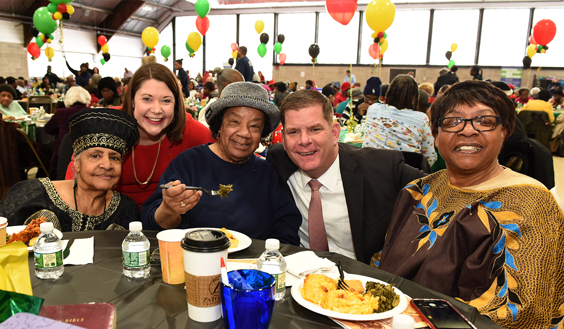 Emily Shea (far right) and Boston Mayor Martin Walsh (second from right) at a senior citizen event