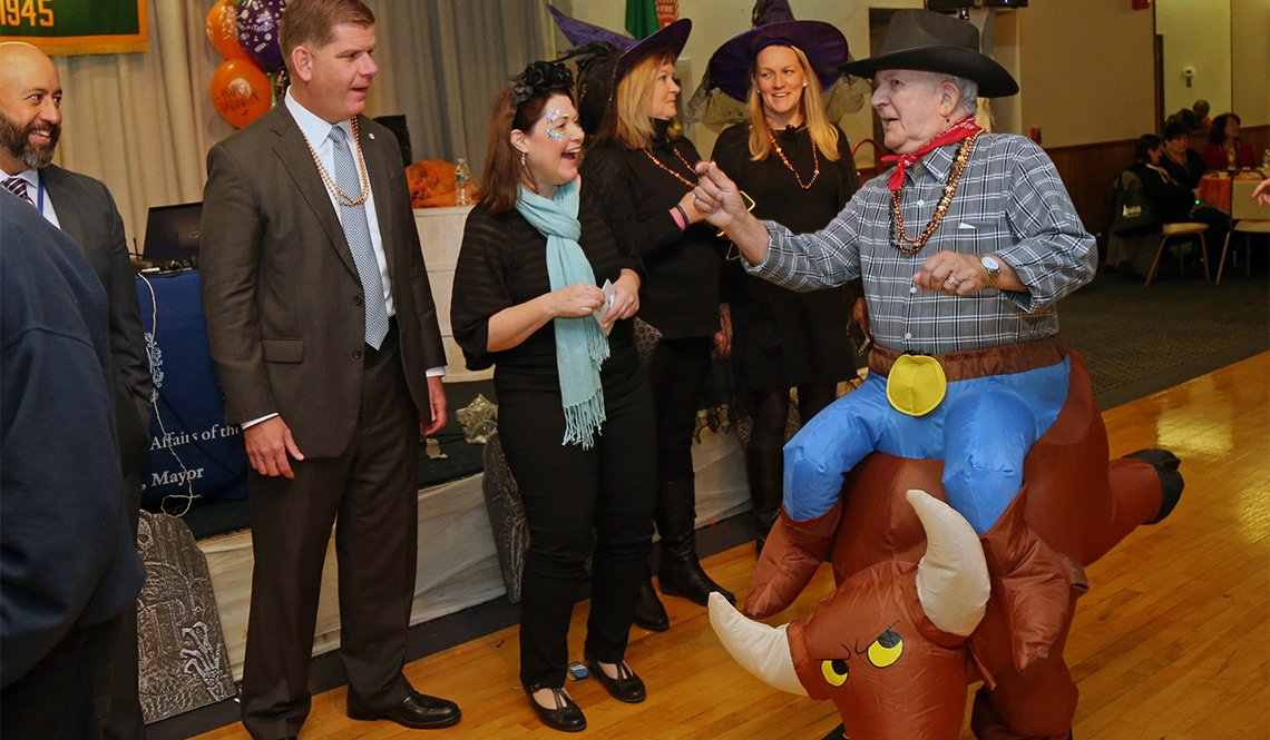 Emily Shea (laughing) and Boston Mayor Martin Walsh (second from left) at a Halloween event