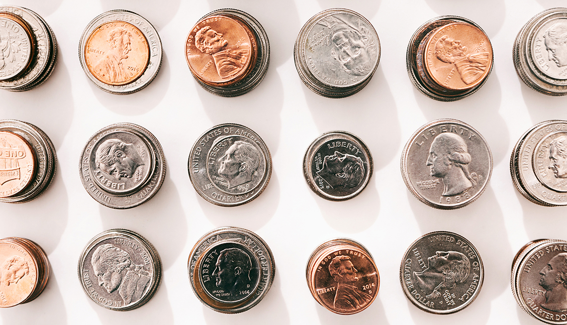columns of u s coins of different denominations set up in stacks and photographed from above to create a pattern of rows