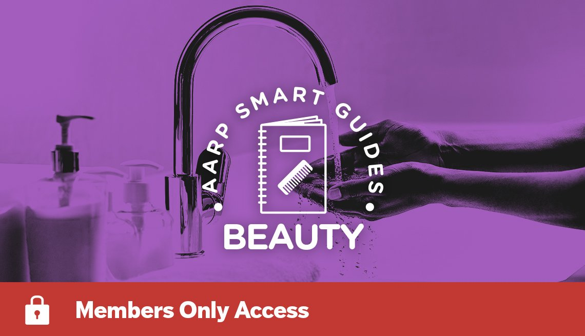 "purple-tinted photo of woman's hands under faucet behind words ""aarp smart guides beauty"""