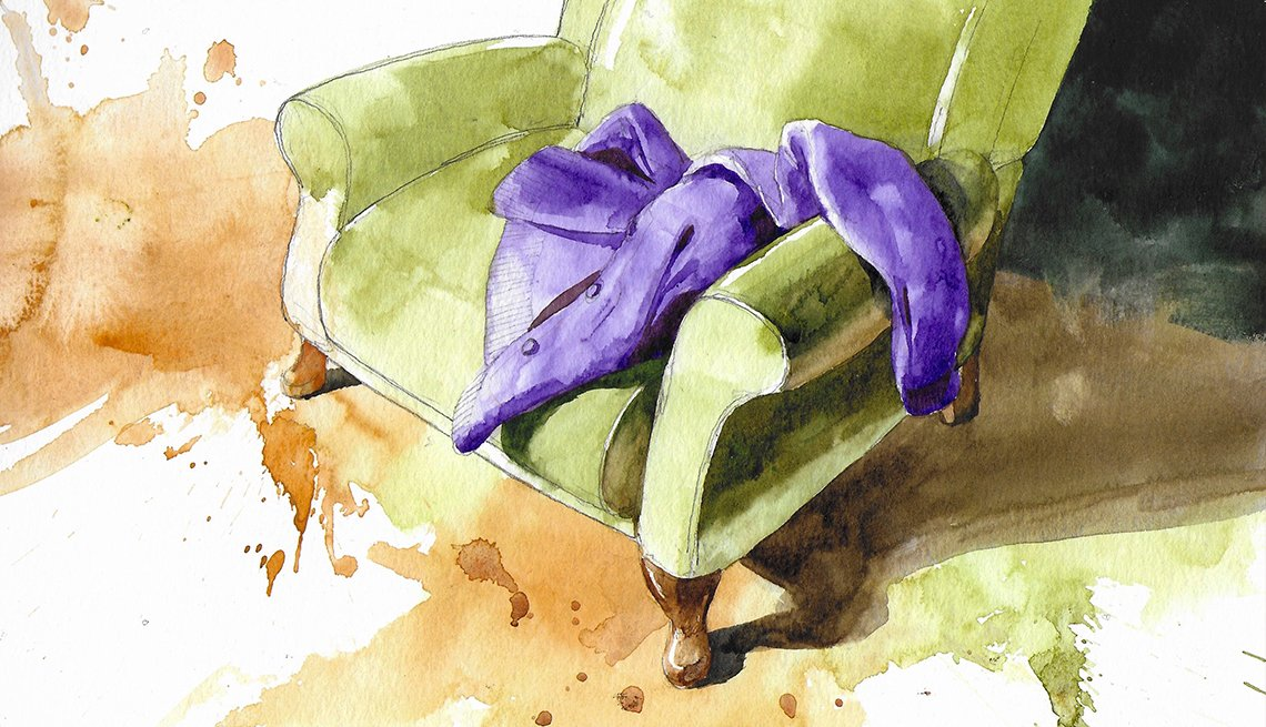 a green armchair with a purple jacket laying on it