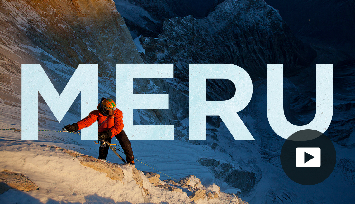 Climber Jimmy Chin on mountain with MERU written across image