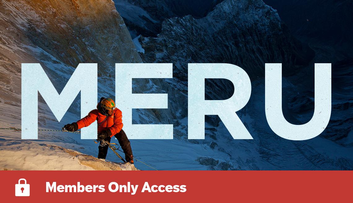 Climber Jimmy Chin on mountain with MERU written across image